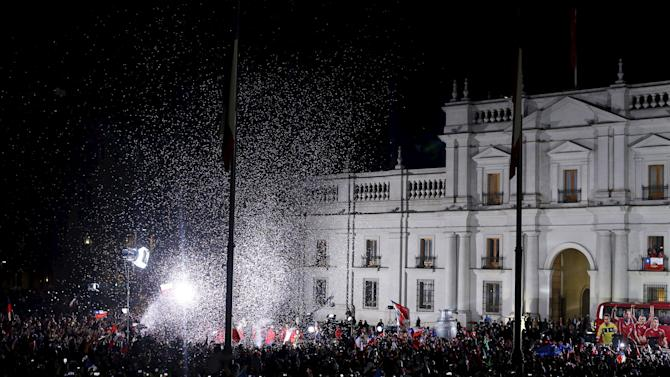 Fans celebrate outside the La Moneda presidential palace after Chile defeated Argentina to win the Copa America final soccer match in Santiago, Chile