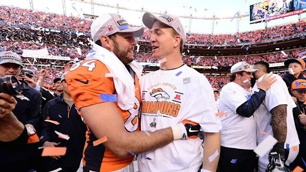 Denver Broncos quarterback Peyton Manning (18) celebrates with tight end Jacob Tamme (84) the 26-16 victory against the New England Patriots following the 2013 AFC Championship football game at Sports Authority Field at Mile High (Reuters)