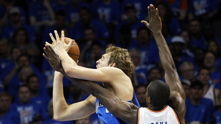 Dallas Mavericks forward Dirk Nowitzki, left, shoots as Oklahoma City Thunder forward Serge Ibaka (9) defends in the first quarter of Game 1 in a first-round NBA basketball playoff series in Oklahoma City, Saturday, April 28, 2012. (AP Photo/Sue Ogrocki)
