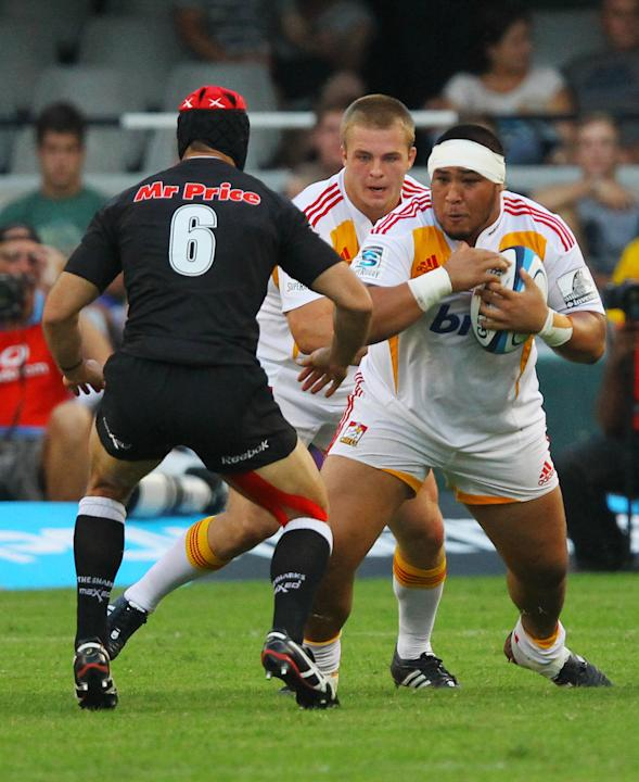 New Zealand Waikato Chiefs' Ben Tameifuna (R) runs into Sharks of Durban's Jacques Botes (L) during the Super 15 rugby union match Sharks of Durban vs Waikato Chiefs of New Zealand at the Mr Price Kin