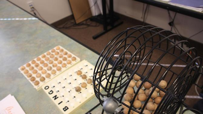 This May 27, 2013 photo shows a bingo basket at the Grand Staircase-Escalante visitor's center in Kanab, Utah, that is used to determine who gets 10 permits for the next day's hike to a rock formation known as The Wave in the Vermilion Cliffs National Monument. Another 10 spots are decided daily by an online lottery four months in advance. Access to the site in the Arizona-Utah desert backcountry is limited to preserve the area and to maintain the wilderness experience. (AP Photo/Brian Witte)