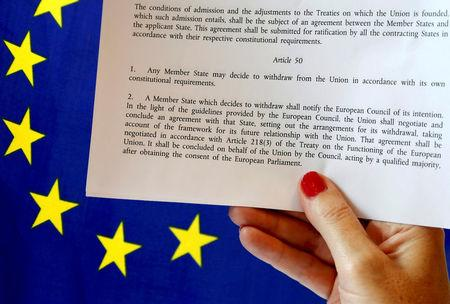 Article 50 of the EU's Lisbon Treaty is pictured near an EU flag following Britain's referendum results to leave the European Union, in this photo illustration taken in Brussels
