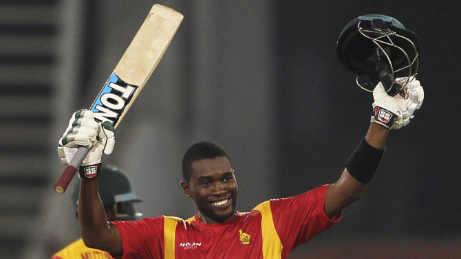 FILE - In this Tuesday, May 26, 2015 file photo, Zimbabwe's Elton Chigumbura acknowledges his century against Pakistan during a one-day international match at the Gaddafi Stadium in Lahore, Pakistan. Chigumbura will miss the rest of the one-day international series against Pakistan after being suspended for two matches for maintaining a slow over rate in Tuesday's first ODI. (AP Photo/K.M. Chaudary,file)