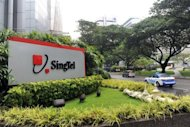 The SingTel corporate building in Singapore. Temasek&#39;s sale of SingTel shares came a day after it was reported to be sounding out potential buyers for its 18-percent stake in British bank Standard Chartered worth 6.0-billion ($9.7 billion)
