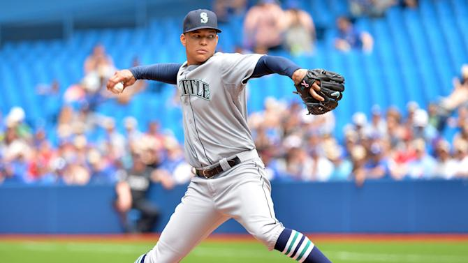 Seattle Mariners starter Taijuan Walker delivers to the Toronto Blue Jays during first-inning baseball game action in Toronto, Sunday, May 24, 2015. (Frank Gunn/The Canadian Press via AP) MANDATORY CREDIT