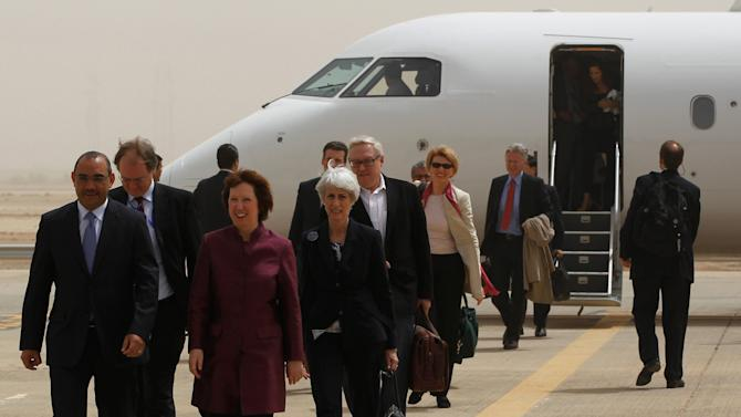 World powers negotiators arrive at the Baghdad International Airport in Iraq, Wednesday, May 23, 2012. Negotiators from the U.S. and five other world powers sat down Wednesday with a team of Iranian diplomats to try to hammer out specific goals in the years-long impasse over Tehran's nuclear program.(AP Photo/Mohammed Ameen, Pool)