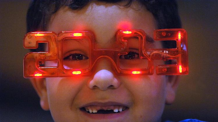 Evan Spindler, 7, wears 2013 glasses on Monday, Dec. 31, 2012 during the 14th Annual 2013 First Night Scranton New Year's Eve festivities in downtown Scranton, Pa. (AP Photo/The Scranton Times-Tribune, Butch Comegys) WILKES BARRE TIMES-LEADER OUT; MANDATORY CREDIT