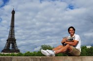 PARIS, FRANCE - JUNE 11:  Rafael Nadal of Spain poses with the Coupe des Mousquetaires trophy in front of the Eiffel Tower after his victory against Novak Djokovic of Serbia during day 16 of the French Open at Roland Garros on June 11, 2012 in Paris, France.  (Photo by Mike Hewitt/Getty Images)