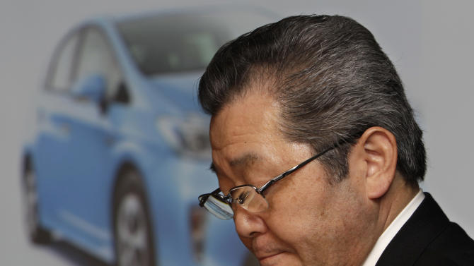 Toyota Motor Corp. Senior Managing Officer Takahiko Ijichi looks down during a press conference at Toyota's Tokyo headquarters Tuesday, Feb. 7, 2012. Toyota's quarterly profit slid 13.5 percent on production setbacks caused by last year's tsunami disaster and the flooding in Thailand, but Japan's top automaker raised its annual earnings forecast, saying a recovery is on track. (AP Photo/Shizuo Kambayashi)