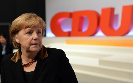 <p>Angela Merkel attends the CDU conference in Hanover. Merkel was overwhelmingly re-elected her party's leader Tuesday as she kicked off her bid for a third term, saying only she could steer Germany through turbulence at home and abroad.</p>