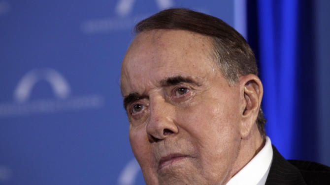 """FILE - In this March 21, 2012, file photo, former Senate Majority Leader Bob Dole looks to the stage during an event honoring Dole and Howard Baker at Mellon Auditorium in Washington. Dole has checked himself into Walter Reed Army Medical Center for what his spokesman said on Monday, Nov. 27, 2012, was a routine procedure. Dole spokeswoman Marion Watkins says the 89-year-old Dole is """"doing very well"""" and is expected to leave the hospital Wednesday. (AP Photo/Carolyn Kaster, File)"""