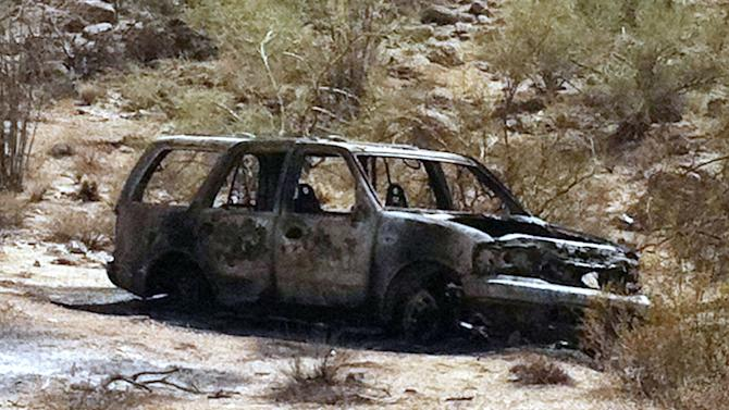 This image provided by the Pinal County Sheriffs Office, shows the vehicle where five burned, dead bodies were found, in Pinal County's Vekol Valley area, west of Casa Grande, Ariz. The bodies were so badly burned that investigators couldn't immediately determine their gender or ethnicity. Authorities say the incident may be drug related. (AP Photo/ Pinal County Sheriffs Office)