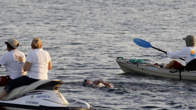 British-Australian swimmer Penny Palfrey begins her bid to complete a record swim from Cuba to Florida, in Havana, Cuba, Friday, June 29, 2012. Palfrey aims to be the first woman to swim the Straits of Florida without the aid of a shark cage. Instead she's relying on equipment that surrounds her with an electrical field to deter the predators. (AP Photo/Franklin Reyes)