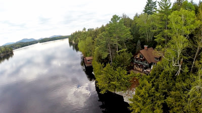 This rarely offered year-round Adirondack home on Ampersand Bay on the north end of Saranac Lake in an exclusive neighborhood of 12 waterfront homes s...