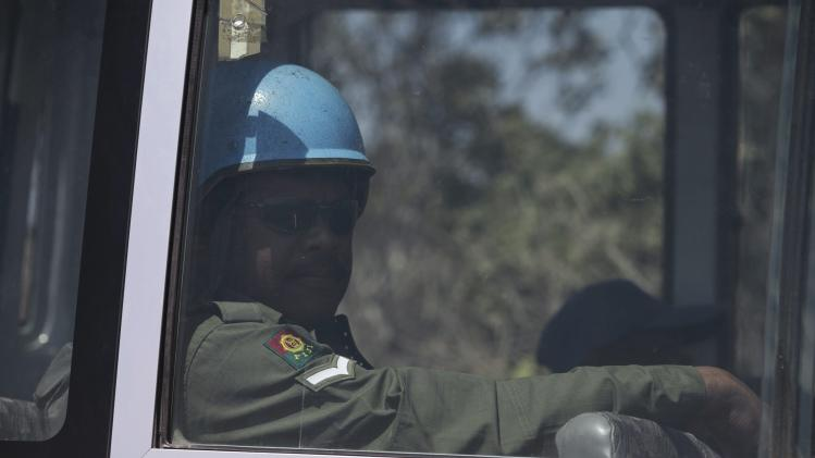 A U.N. peacekeeper from Fiji is seen through a bus window in the Israeli-occupied Golan Heights