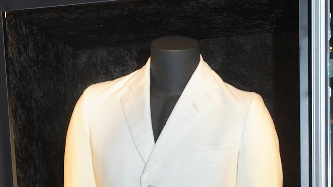 """John Lennon's white suit, which he wore in the early '70s, is displayed at the launch of Hard Rock International's traveling music memorabilia collection, """"Music GIves Back,"""" Wednesday, Feb. 13, 2013, at Hard Rock Cafe New York.   """"Music Gives Back"""" focuses on artists who have worked with Hard Rock on charitable campaigns  and will be on tour at Hard Rock locations in the U.S. throughout 2013. (Photo by Diane Bondareff/Invision for Hard Rock International/AP Images)"""