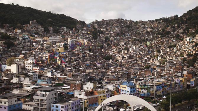 Buildings crowd the Rocinha shantytown in Rio de Janeiro, Brazil, Tuesday, May 22, 2012. Local officials and human rights groups are working to give legal title to tens of thousands of residents of shantytowns like Rocinha, a process that increases their wealth and gives them greater access to credit, as well as peace of mind. The programs so far are just a start at tackling a widespread problem: A third of the people in Rio state, nearly 5 million people, don't have title to their homes, an uncertainty shared by most of the approximately 1 billion people who living in slums globally. (AP Photo/Felipe Dana)