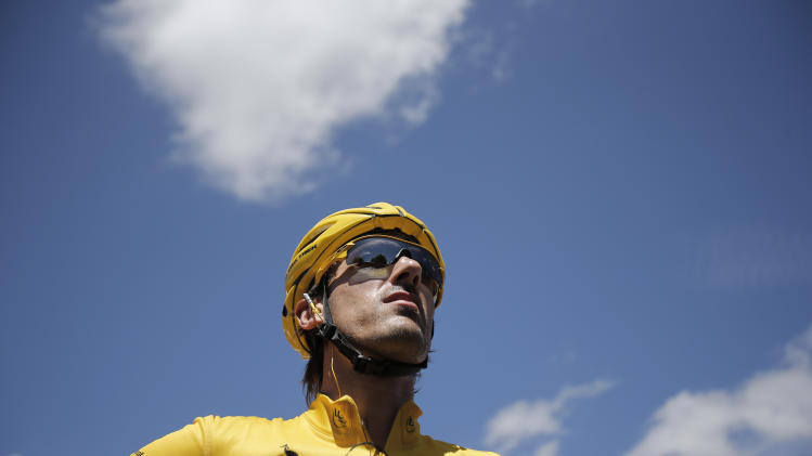 Fabian Cancellara of Switzerland, wearing the overall leader's yellow jersey, waits for the start of the seventh stage of the Tour de France cycling race over 199 kilometers (123.6 miles) with start in Tomblaine and finish in La Planche de Belles Filles, France, Saturday July 7, 2012. (AP Photo/Christophe Ena)