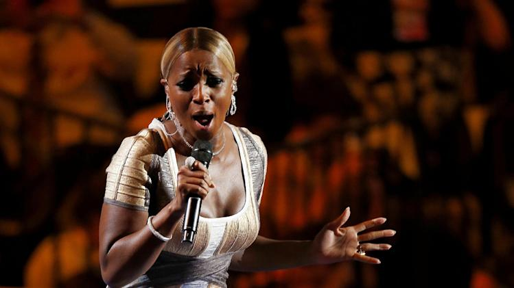 FILE - This Sept. 6, 2012 file photo shows singer Mary J. Blige performing during the Democratic National Convention in Charlotte, N.C. Blige was honored Friday, Feb. 8, 2013 by Vibe magazine during a pre-Grammy party in Los Angeles.  (AP Photo/Carolyn Kaster, file)