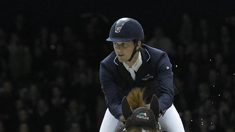 Billy Twomey, of Ireland, rides his horse Tinka's Serenade during the FEI World Cup Jumping competition in Lyon, central France, Saturday April 19, 2014. (AP Photo/Laurent Cipriani)
