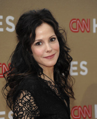 "FILE - In this Sunday, Dec. 11, 2011 file photo, actress Mary-Louise Parker arrives at the Fifth Annual CNN Heroes: All-Star Tribute, in Los Angeles. ""Weeds"" stars Mary-Louise Parker as a suburban widow who turns to selling marijuana to support her family. ""Weeds"" ends its eight-season run Sunday, Sept. 16, 2012.(AP Photo/Dan Steinberg, File)"