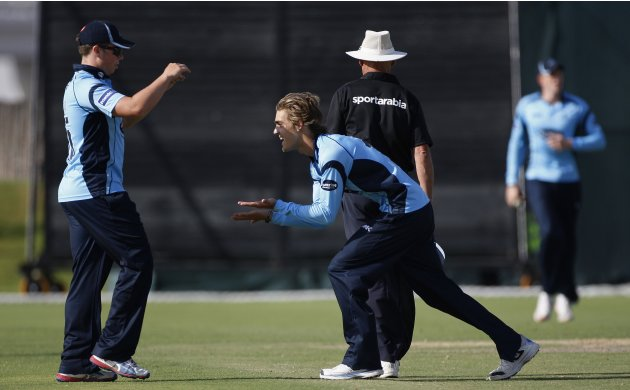 Sussex Sharks' Rippon celebrates the wicket of Fly Emirates XI's Ali during the Emirates Twenty20 final cricket match in Dubai