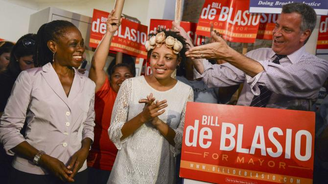 New York mayoral candidate Blasio introduces his wife McCray, as their daughter Chaiara applauds during a campaign rally in Brooklyn, New York