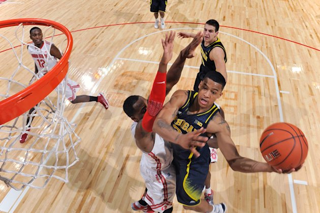 COLUMBUS, OH - JANUARY 13: Trey Burke #3 of the Michigan Wolverines drives to the basket and shoots over Deshaun Thomas #1 of the Ohio State Buckeyes in the first half on January 13, 2013 at Value City Arena in Columbus, Ohio. Ohio State defeated Michigan 56-53. (Photo by Jamie Sabau/Getty Images)