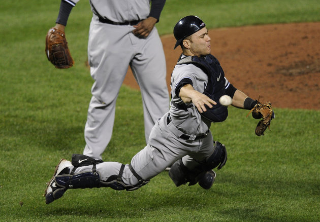 New York Yankees catcher Russell Martin throws out Baltimore Orioles' Lew Ford, not pictured, at first base in the fifth inning of Game 1 of the American League division baseball series on Sunday,