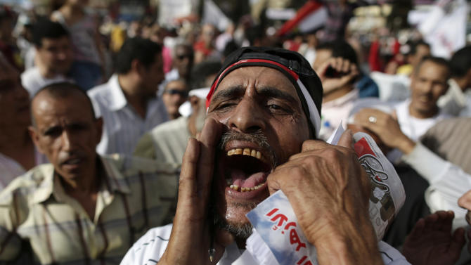 Egyptian protesters shout anti-President Mohammed Morsi slogans in Tahrir Square, in Cairo, Egypt, Friday, May 17, 2013. Hundreds of protesters gathered to demand early presidential elections and the removal of the Muslim Brotherhood's regime. (AP Photo/Hassan Ammar)