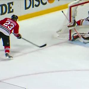 Andersen stretches out his pad to rob Versteeg