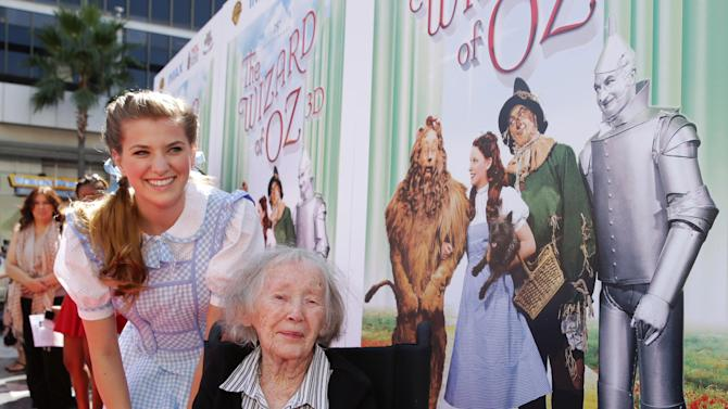 """This Sept. 15, 2013 photo provided by Warner Bros. Home Entertainment shows Danielle Wade, left, and Ruth Duccini at Warner Bros. world premiere screening of """"The Wizard of Oz"""" in IMAX 3D and the grand opening of the newly converted TCL Chinese Theatre IMAX in the Hollywood section, of Los Angeles. Ruth Robinson Duccini, one of the original Munchkins from the 1939 movie """"The Wizard of Oz,"""" has died, Thursday, Jan. 16, 2014. She was 95. (AP Photo/Warner Bros. Home Entertainment/, Eric Charbonneau)"""