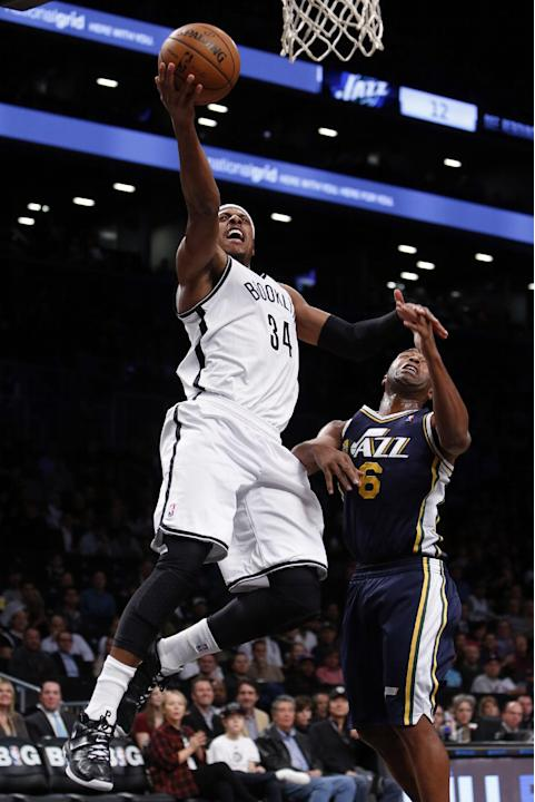 Brooklyn Nets' Paul Pierce (34) goes the basket against Utah Jazz's Jamaal Tinsley (6) during the second half of an NBA basketball game Tuesday, Nov. 5, 2013, in New York. Brooklyn won 104-88