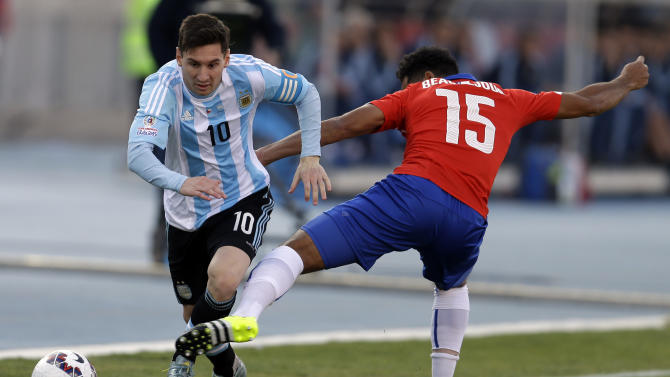 Argentina's Lionel Messi  dribbles past Chile's Jean Beausejour  during the Copa America final soccer match at the National Stadium in Santiago, Chile, Saturday, July 4, 2015. (AP Photo/Natacha Pisarenko)