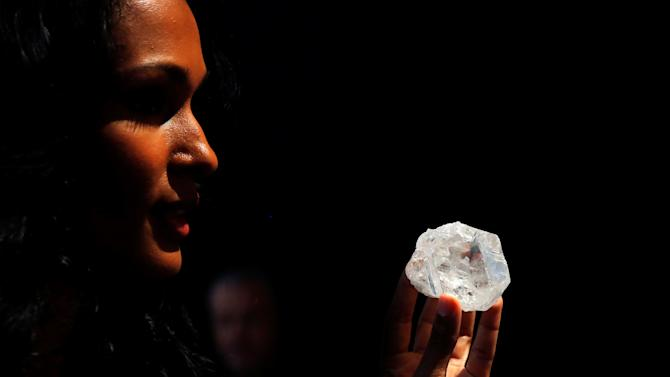 "A model displays the 1109 carat ""Lesedi La Rona"" diamond at Sotheby's in the Manhattan borough of New York"