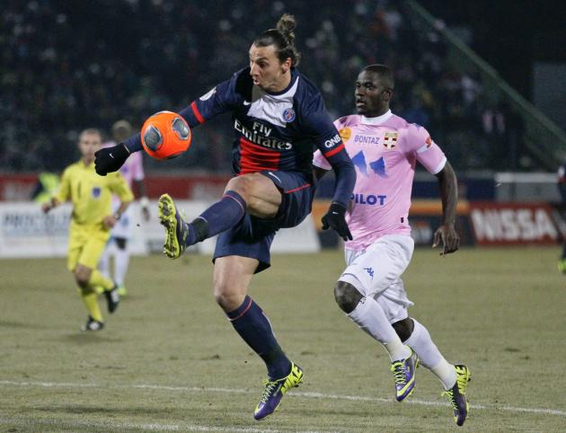 Ibrahimovic of Paris St-Germain challenges Mensah of Evian Thonon Gaillard during their French Ligue 1 match in Annecy