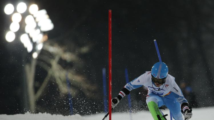 Austria's Thomas Grochar skis during the men's standing slalom event at the 2014 Sochi Paralympic Winter Games at the Rosa Khutor Alpine Center