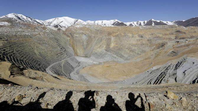 The Kennecott Utah Copper Bingham Canyon Mine is shown during a media tour Thursday, April 25, 2013, following a April 10, landslide, in Bingham Canyon, Utah. The chief of Kennecott Utah Copper guided media to the rim of Bingham Canyon Mine for a view of a massive landslide that stopped operations April 10 when 165 million tons of rock and dirt ran down a wall of the open pit. (AP Photo/Rick Bowmer)