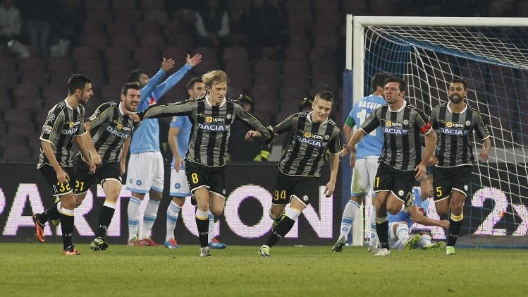 Udinese's Basta celebrates with his team mates after scoring against Napoli during their Italian Serie A soccer match at San Paolo stadium in Naples