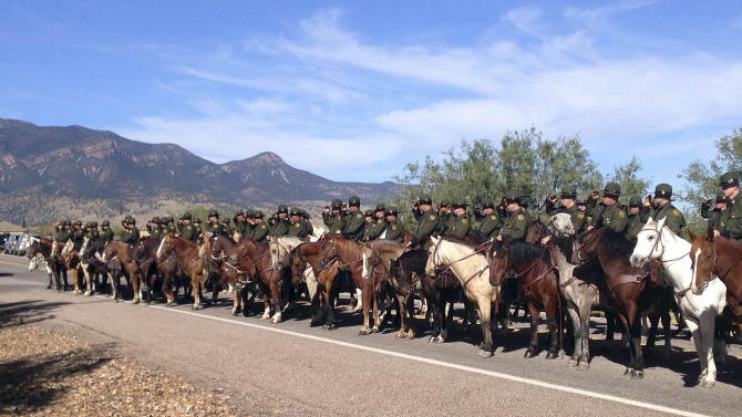 Mounted officers line the route during the funeral procession for slain U.S. Border Patrol agent Nicholas Ivie on Monday, Oct. 8, 2012, at the Church of Jesus Christ of Latter Day Saints in Sierra Vista, Ariz.  The head of the U.S. Border Patrol agents' union says the agent was killed when he  apparently opened fire on two colleagues thinking they were armed smugglers and was killed when they returned fire. (AP Photo/Brian Skoloff)