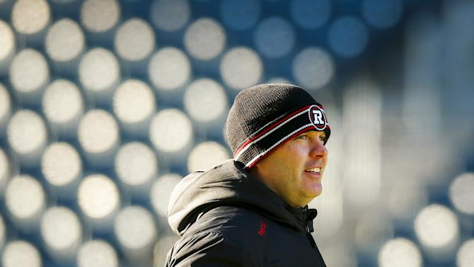 Redblacks coach Rick Campbell looks on during their team's walkthrough practice ahead of the CFL 103rd Grey Cup championship football game in Winnipeg