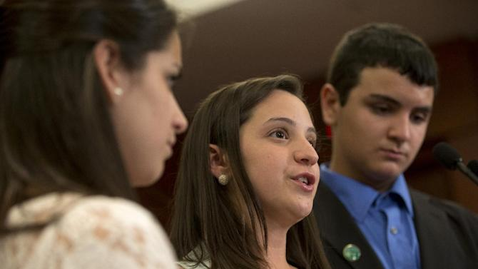 Jillian Soto, center, with siblings Carlee Soto, left and Carlos Soto, the siblings of Victoria Soto, speaks during a news conference on Capitol Hill in Washington, Thursday, June 13, 2013, on the sixth month anniversary of the Newtown, Conn. shootings. (AP Photo/Jacquelyn Martin)