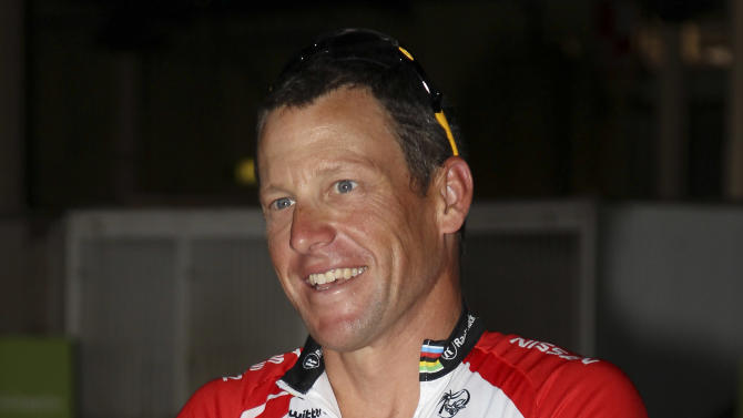 FILE - This Jan. 24, 2011 file photo shows Seven-time Tour de France champ Lance Armstrong preparing to ride in a 25-kilometer flood fundraiser in Brisbane, Australia. Armstrong will be back on the bike competing in the XTERRA USA Championship at Snowbasin Ski Resort in Utah.  Armstrong has confirmed he will compete Sept. 24 in the XTERRA course that covers a 1-mile swim, 20-mile mountain bike ride and 6-mile trail run. (AP Photo/Tertius Pickard, FIle)