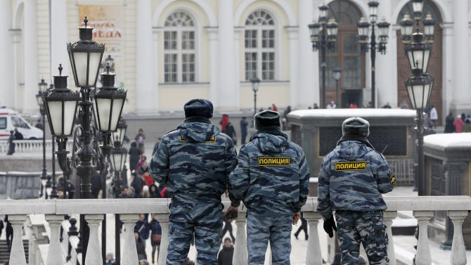 Russian police officers patrol in Manezh Square in downtown Moscow, Russia, Saturday, March 3, 2012. Security is being tightened on the eve of the Russian presidential election. (AP Photo/Misha Japaridze)