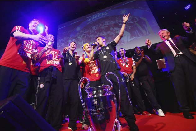 Bayern Munich's coach Jupp Heynckes and players celebrate at the team's banquet at Grosvenor House in London