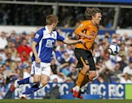 Jimmy Bullard (right) in action for Hull against Birmingham City's Sebastian Larsson at St. Andrews in 2010. The former Fulham and Wigan midfielder announced his retirement on Monday after conceding defeat in his battle to recover from a series of knee problems