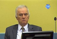 A screen grab released by the International Criminal Tribunal for the former Yugoslavia (ICTY) shows former Bosnian Serb army chief Ratko Mladic sitting in the courtroom at The Hague. Mladic's genocide and warcrimes trial -- which was adjourned a day after it opened -- will resume on June 25, according to the Yugoslav war crimes tribunal
