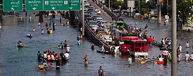 Evacuees pour into relief centers across Bangkok as flood water creep into the capital's suburbs.