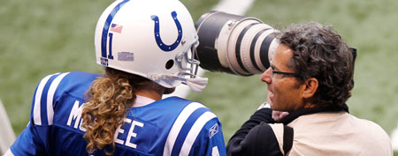 Pat McAfee of the Indianapolis Colts pats a sideline photographer during the game against the Atlanta Falcons at Lucas Oil Stadium on November 6 in Indianapolis. (Photo by Joe Robbins/Getty Images)