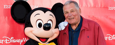 Then-Braves manager Bobby Cox walks the red carpet with Mickey Mouse at the official relaunch of the ESPN Wide World of Sports at Walt Disney World Resort on February 25, 2010 in Lake Buena Vista, Florida. (Photo by Matt Stroshane/Getty Images)